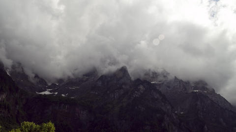 Timelapse: Clouds move around a mountain Footage