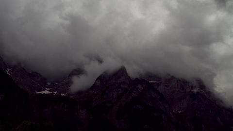 Timelapse: Clouds move around a mountain Stock Video Footage