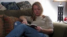 Girl on sofa 4 Stock Video Footage