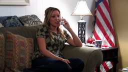 Patriotic girl using telephone Footage