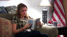 Girl on sofa 3 Stock Video Footage