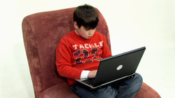 Boy on couch close panning Stock Video Footage