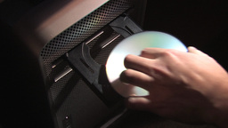 Inserting Compact Disc Into Computer Stock Video Footage