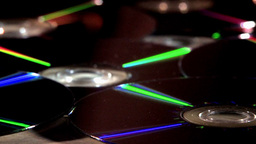 Compact Discs (CDs) Rotating With Reflective Surfaces Stock Video Footage