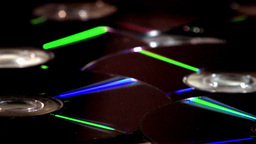 Compact Discs (CDs) Rotating With Reflective Surfaces Footage