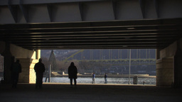 People Walking From Under A Bridge To Scenic Lake Stock Video Footage
