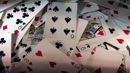 Zooming Out From A Rotating Pile Of Cards - High... Stock Video Footage