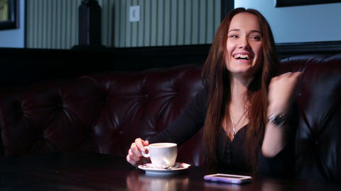 Girl laughs Over A Cup Of Coffee Stock Video Footage