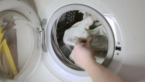 Throwing clothes to washing machine Stock Video Footage