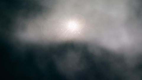 Sun Peeking Through Stormy Clouds Loop Stock Video Footage