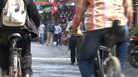 Bikes and people walking around Stock Video Footage