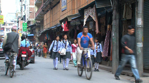 Busy street with school kids in Thamel Footage