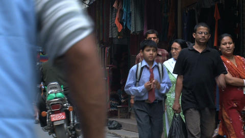 Busy street with school kids in Thamel Kathmandu Stock Video Footage