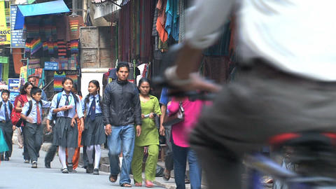 Busy street with school kids in Thamel Kathmandu Footage