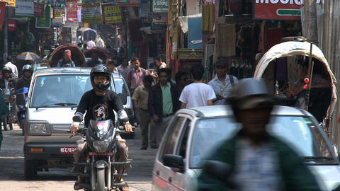 Busy street in the thamel district kathmandu with motors and cars Footage
