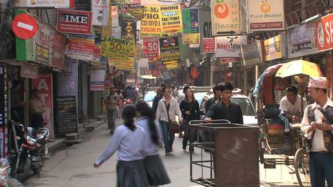 Narrow street in the Thamel district in Kamthmandu Stock Video Footage