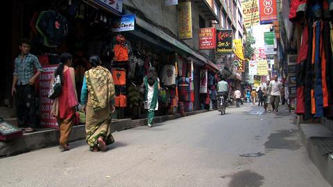 People in a narrow street in Thamel Kathmandu Stock Video Footage