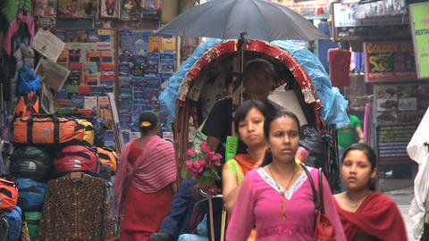 Busy street with bike taxi in Thamel Kathmandu Stock Video Footage