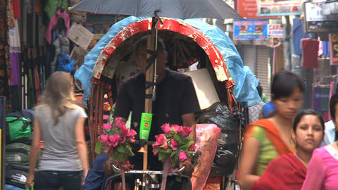 Busy street with bike taxi in Thamel Kathmandu Footage