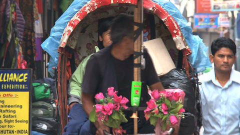 Busy street with bike taxi in Thamel Kathmandu Stock Video Footage
