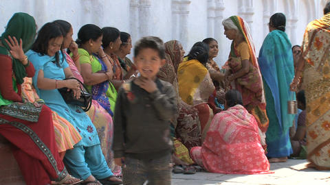 Little boy in front of a group of women Stock Video Footage