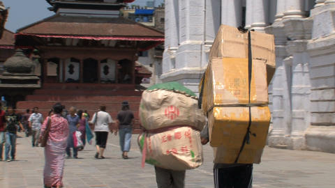 People walking with heavy boxes Stock Video Footage