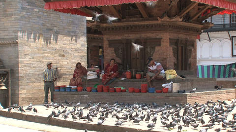 People passing by a temple at Durbar Square Stock Video Footage