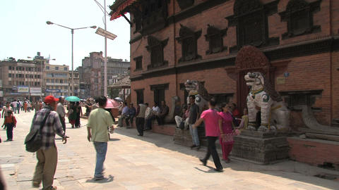 People walking around a temple Stock Video Footage