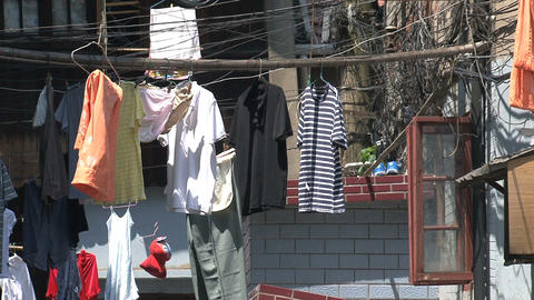 Clothes hanging in old chinees street zoom out Stock Video Footage