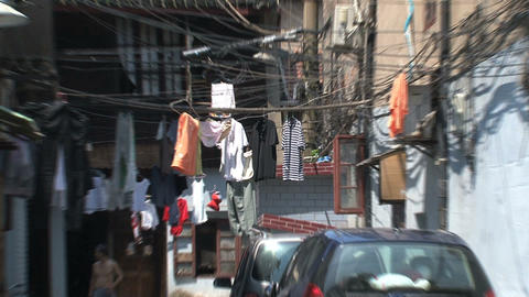 Clothes hanging in old chinees street zoom out Footage