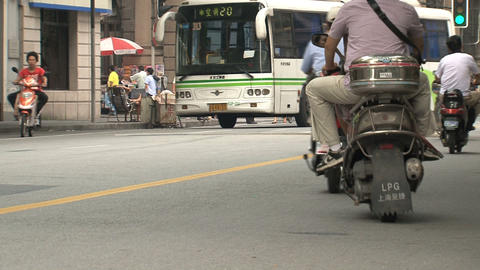 Scooters and bikes in Shanghai Stock Video Footage