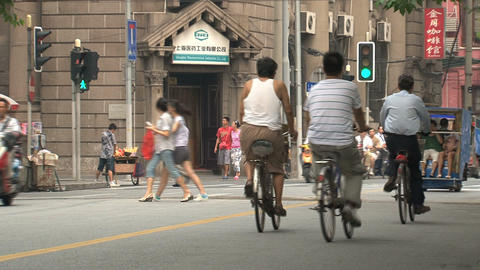 Scooters and bikes downtown Shanghai Stock Video Footage