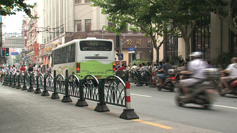 Scooters traffic downtown Shanghai Stock Video Footage