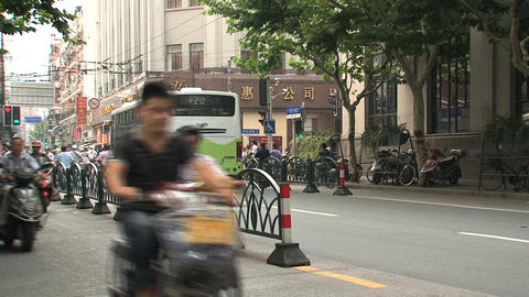Scooters traffic downtown Shanghai Footage