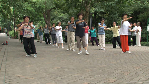Group people doing Tai Chi zoom out Footage