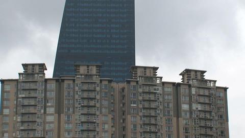Skyscraper tilt to mothers and children Stock Video Footage