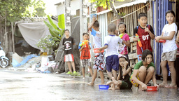Children Splashing Cars During Songkran Festival Footage