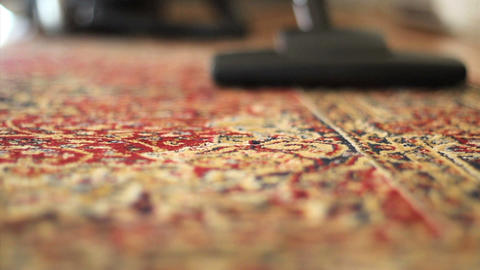 Vacuuming Colorful Carpet Low Angle Stock Video Footage