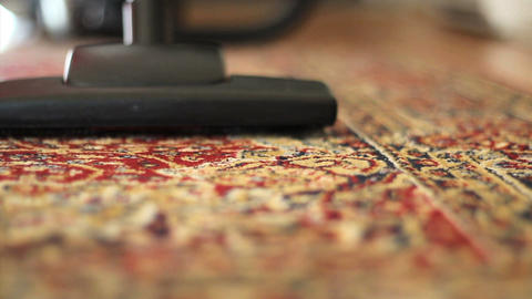 Vacuuming Colorful Carpet Low Angle Footage