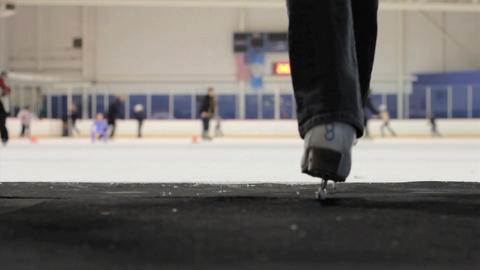 Woman Walks Onto The Ice At The Skating Rink Footage