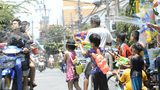 Children Splashing Passing Motorbikes During Songkran Festival Footage