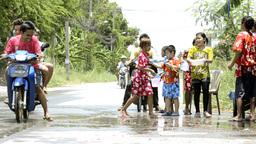 Children Splashing Passing Motorbikes During Songkran... Stock Video Footage