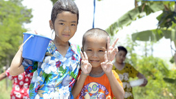 Girl Pouring Water Over Boys For Songkran Stock Video Footage