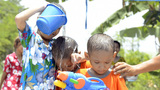 Girl Pouring Water Over Boys For Songkran Footage
