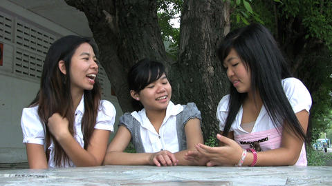 Three Asian Students Hanging Out stock footage