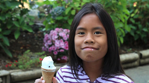 Young Asian Girl Eating Ice Cream Cone Stock Video Footage