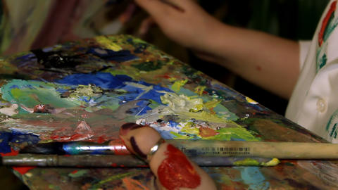 Mixing of the paint on the palette and painting Footage