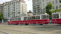 Red tram on the street of Vienna, Austria Live Action