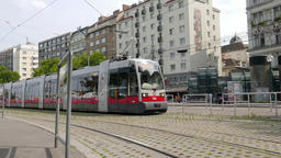 Modern red tram on the street of Vienna. Daily life scene Footage