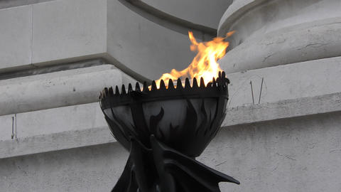 On the wall hangs a torch. Flames of fire dancing in the wind Live Action
